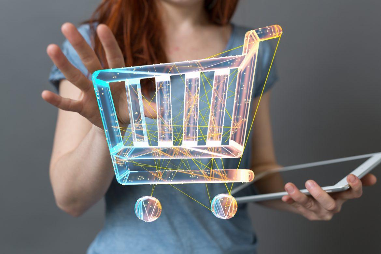 shopping 3d, immagine di un carrello, un ologramma con una ragazza dietro e un tablet in mano. compra da amazon